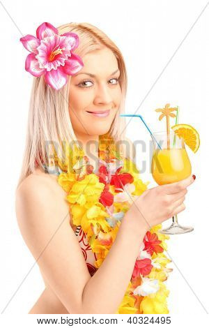 A smiling young woman dressed in a traditional costume drinking cocktail isolated on white background