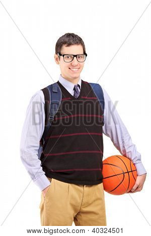 A smiling male student with school bag holding a basketball isolated on white background