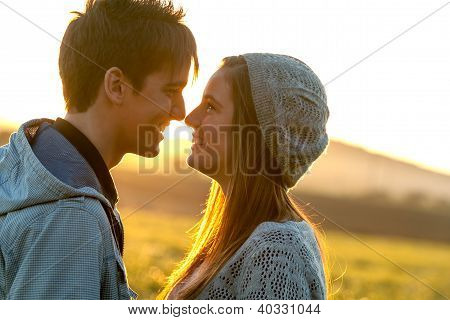 Romantic Couple Showing Affection At Sunset.