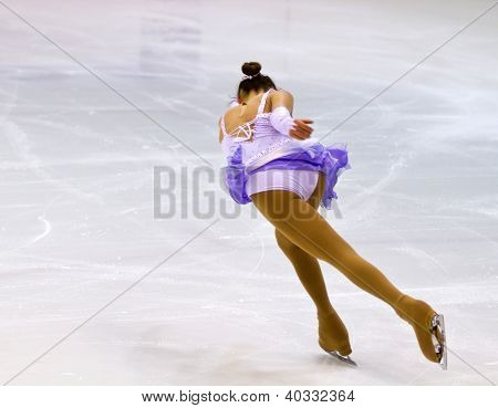 a woman figure skater performing on ice