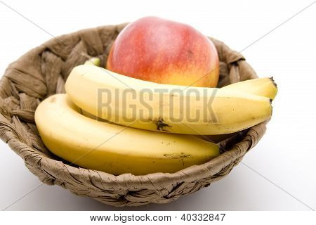 Yellow bananas and apple