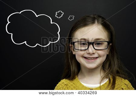 Smart Young Girl Stood Infront Of A Blackboard