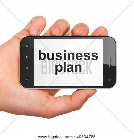 Hand holding smartphone with word business plan on display. Gene