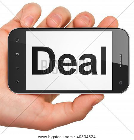 Hand holding smartphone with word Deal on display. Generic mobil