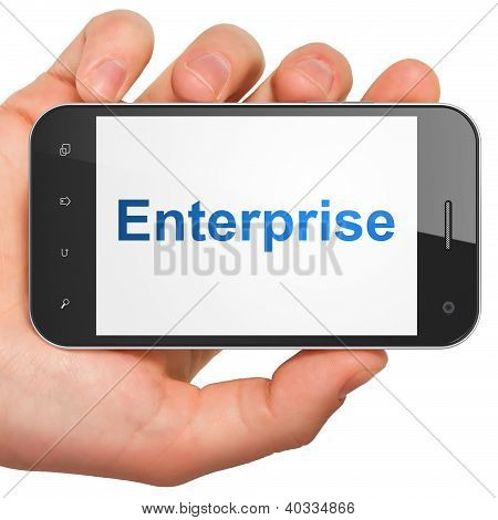Hand holding smartphone with word Enterprise on display. Generic