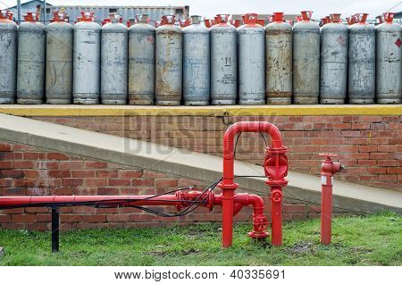 Fire Hydrant Water Pipe In Front Of Lpg Gas Bottles