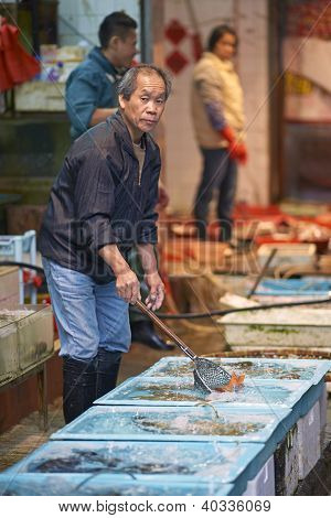 Man selling fish