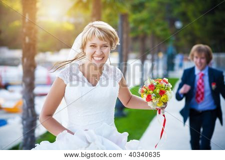 happy couple in a sunny summer park