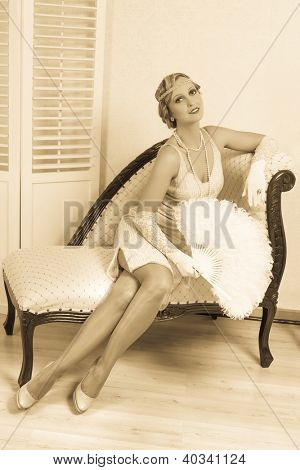Vintage flapper dress lady holding an antique feather fan