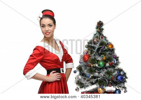 cheerful retro girl standing near christmas tree