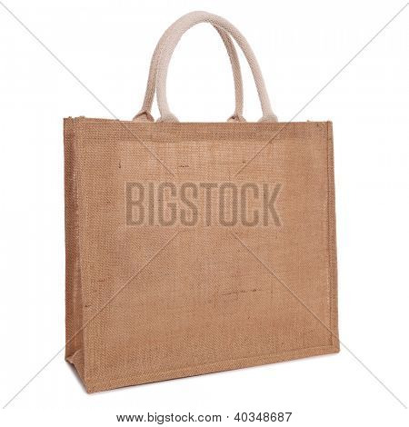 A recycled hessian or jute shopping bag isolated on white background.