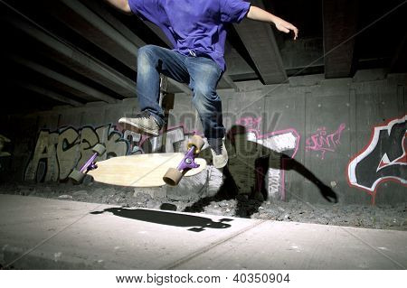 Young Teenager Flipping His Longboard