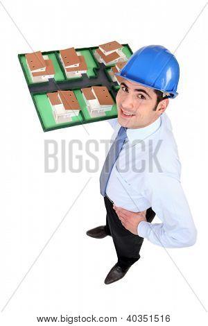 Man holding model of housing