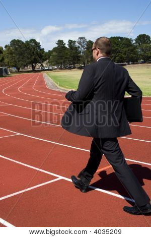 Business Man On Running Track