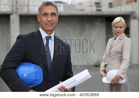 couple of executive in a construction site
