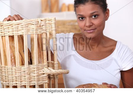 Baker posing with her bread