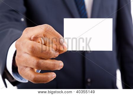 Close-up of business man handing a blank business card over white background