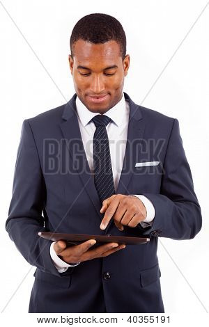 Thoughtful african american young businessman with tablet computer, isolated on white