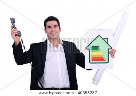 commercial agent holding an energy consumption label and a phone
