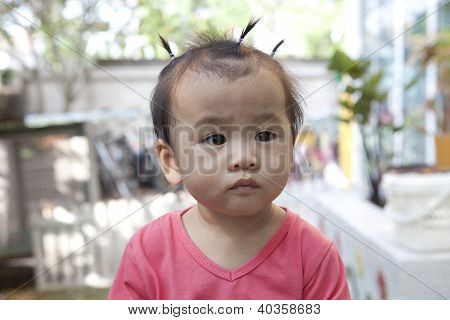 face of asian baby with dressing hair