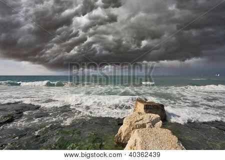 Severe storm cloud over the surf. Mediterranean Sea, Israel