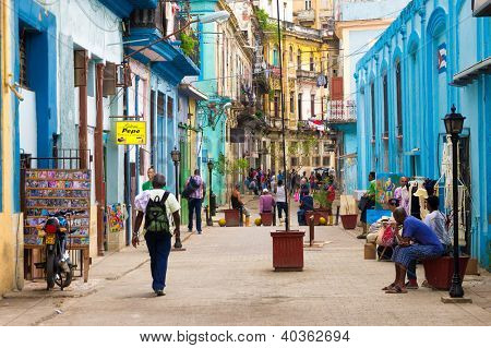 HAVANA-DECEMBER 14:Street scene with cuban people and colorful old buildings December 14,2012 in Havana.Founded in 1515,Havana is the largest city in the Caribbean with 2.4 million inhabitants