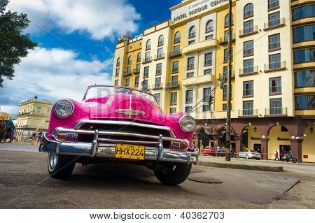 HAVANA-DECEMBER 14:Vintage Chevrolet parked in front of the Central Park hotel December 14,2012 in Havana.Thousands of these cars are in use in Cuba and they have become an iconic view of the country