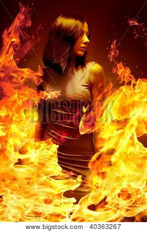Young beautiful girl is in blazing flame