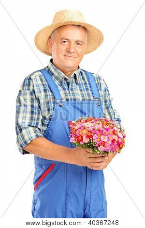Mature gardener with panama hat holding a bunch of flowers isolated on white background