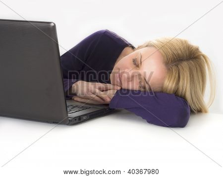 tired women sleeping while using computer