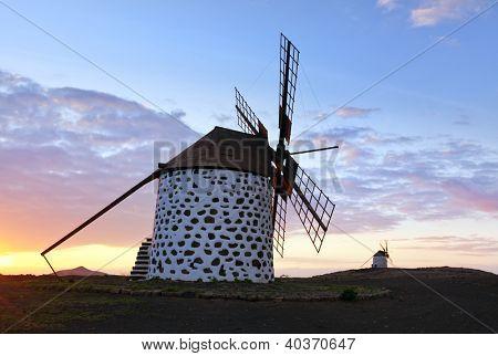 Two old windmills near La Oliva in the sunset