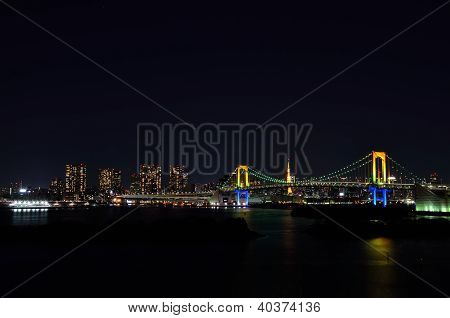 Night View Of The Rainbow Bridge.
