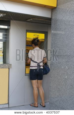 Woman Using Cash Machine/ Atm/ Cash Point/ Hole In The Wall