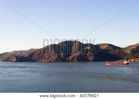Cargo Ship Near The Coastline