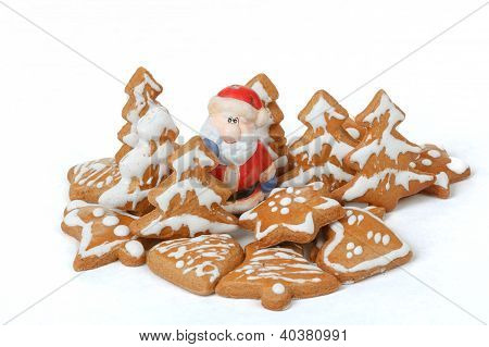 Christmas Gingerbreads And Ceramic Santa On White Background