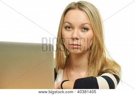 Close-up Of A Sad Young Woman In Front Of The Laptop