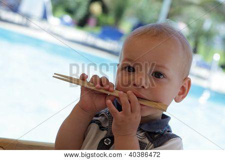 Baby Biting Chopsticks