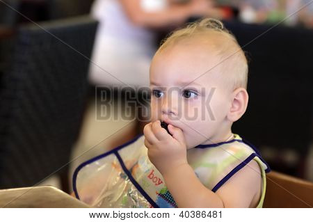 Baby Eating Plum
