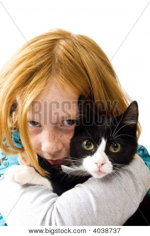 Red Head Girl Holding A Black White Kitten