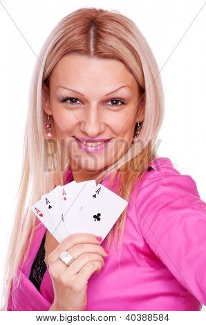Beautiful blonde with smile on the face holding four aces in the hand, isolated on white