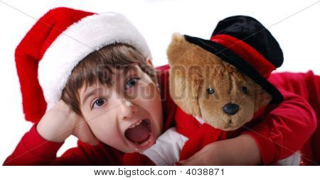 Excited Christmas Kid With Hat And Teddy Bear