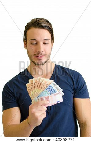 Successful Young Man Looking At Euro Banknotes