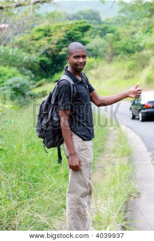 African Traveler Hitchhiking On The Road