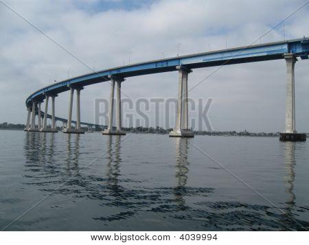 Coronado Bridge From Below On The Water In San Diego, California