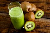 image of centrifuge  - green kiwi juice and some kiwi on wooden table - JPG