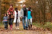 stock photo of enthusiastic  - Happy family with foster children in the forest - JPG