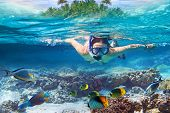 image of undersea  - Young women at snorkeling in the tropical water - JPG