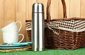 stock photo of thermos  - metal thermos with cups - JPG