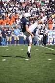 Penn State punter # 30 Anthony Ferra punts against Illinois