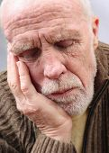 stock photo of nod  - An elderly man who has nodded off sitting up - JPG